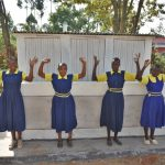 The Water Project: Jimarani Primary School -  Girls Posing At Their New Latrines