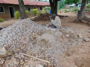 The Water Project:  Breaking Down Rocks Into Gravel