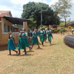 The Water Project: Kitambazi Primary School -  Students Relocating Bricks For Use