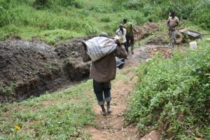 The Water Project:  Community Members Help Deliver Materials