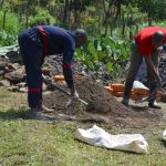 The Water Project: Isanjiro Community, Musambai Spring -  Mixing Cement