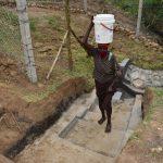 The Water Project: Mukoko Community, Zebedayo Mutsotsi Spring -  Mama Mutsotsi Carries Water Home