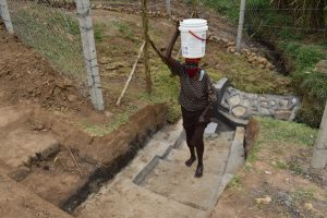 The Water Project:  Mama Mutsotsi Carries Water Home