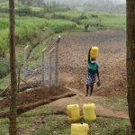 The Water Project: Mukoko Community, Zebedayo Mutsotsi Spring -  Sarah Ambatsi Carrying Her Clean Water Home
