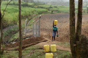 The Water Project:  Sarah Ambatsi Carrying Her Clean Water Home