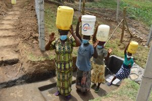 The Water Project:  Women Carrying Their Clean Water Home
