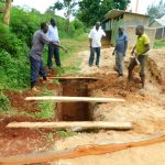 The Water Project: Ibokolo Primary School -  Planing Latrine Foundation Over Pits