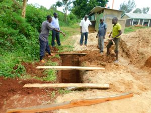 The Water Project:  Planing Latrine Foundation Over Pits