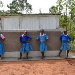 The Water Project: Gidimo Primary School -  Girls Pose At Their New Latrines
