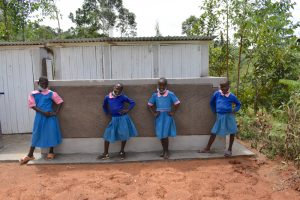The Water Project:  Girls Pose At Their New Latrines