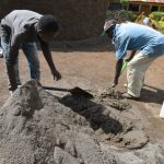 The Water Project: Jimarani Primary School -  Mixing Material For Construction