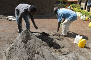 The Water Project:  Mixing Material For Construction