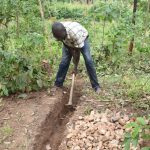 The Water Project: Emutetemo Community, Lubale Spring -  Digging Diversion Channels