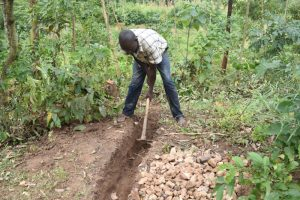 The Water Project:  Digging Diversion Channels