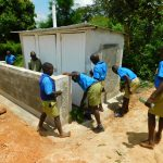 The Water Project: Ibokolo Primary School -  Sweeping Latrines Clean At Training