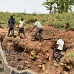 The Water Project: Mushikulu B Community, Olando Spring -  Community Members Lend A Helping Hand