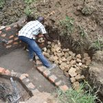 The Water Project: Emutetemo Community, Lubale Spring -  Stone Pitching