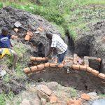 The Water Project: Mabanga Community, Ashuma Spring -  Raising The Walls