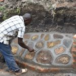The Water Project: Mabanga Community, Ashuma Spring -  Stone Pitching