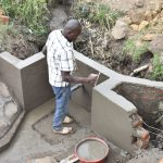 The Water Project: Mabanga Community, Ashuma Spring -  Plastering The Walls