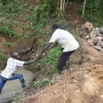 The Water Project: Emutetemo Community, Lubale Spring -  Layer Of Large Rocks