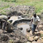 The Water Project: Mabanga Community, Ashuma Spring -  Adding Layer Of Large Rocks