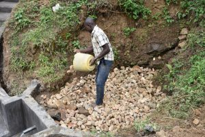 The Water Project:  Layer Of Small Rocks