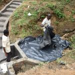 The Water Project: Emutetemo Community, Lubale Spring -  Placing The Tarp