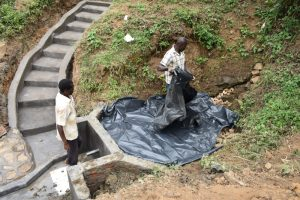 The Water Project:  Placing The Tarp