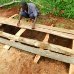 The Water Project: Ibokolo Primary School -  Covering Pits