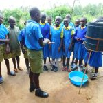 The Water Project: Ibokolo Primary School -  Student Shows Hanwdashing Steps