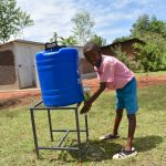 The Water Project: Gidimo Primary School -  Clinton Using A New Handwashing Station