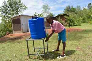 The Water Project:  Clinton Using A New Handwashing Station