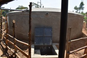 The Water Project:  Completed Rain Tank Wtih Water Flowing