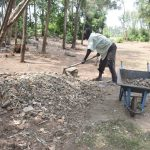 The Water Project: Mabanga Community, Ashuma Spring -  Community Member Preparing Construction Materials