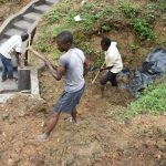 The Water Project: Emutetemo Community, Lubale Spring -  Backfilling With Soil