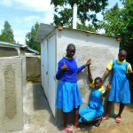 The Water Project: Ibokolo Primary School -  Girls Pose At New Latrines