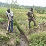 The Water Project: Mabanga Community, Ashuma Spring -  Digging Drainage System