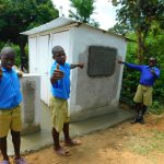 The Water Project: Ibokolo Primary School -  Boys Pose At New Latrines