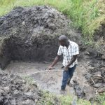 The Water Project: Mabanga Community, Ashuma Spring -  Confirming Measurements Of Excavated Area