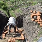 The Water Project: Mabanga Community, Ashuma Spring -  Bricklaying Begins