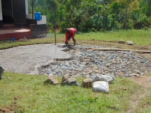 The Water Project:  Laying Concrete Layer