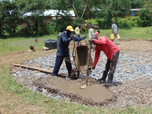 The Water Project:  Laying Concrete On Stones