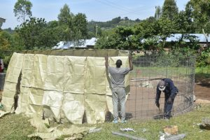 The Water Project:  Placing Sacks On Reinforced Wire
