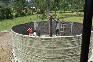 The Water Project:  Setting Pillars For Tank Reinforcement