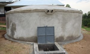 The Water Project:  Complete Rain Tank With Water Flowing