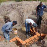 The Water Project: Elwichi Community, Mulunda Spring -  Wall Construction