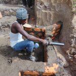 The Water Project: Elwichi Community, Mulunda Spring -  Pipe Setting