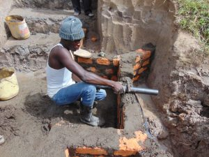 The Water Project:  Pipe Setting