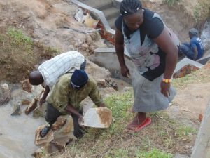 The Water Project:  Backfilling With Rocks